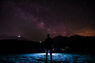 Silhouette man standing on mountain against star field. - INGF05716