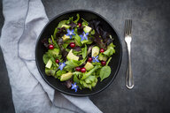 Bowl of mixed salad with avocado, red currants and borage blossoms - LVF07513