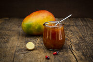 Glass of mango chutney with ginger and chili - LVF07521