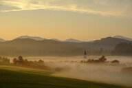Germany, Pfaffenwinkel, view of landscape at morning mist - LBF02156