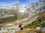Italy, Brescia province, Adamello Alps, Val Salarno, Glacier, hiker looking to glacier - LAF02136