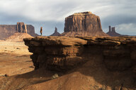 Mid distance view of woman standing by rock formation at Oljato-Monument Valley - CAVF52984