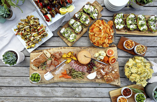 High angle view of various food served on wooden table - CAVF53049