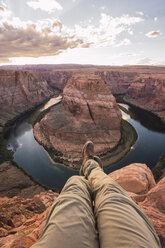 USA, Arizona, Colorado River, Horseshoe Bend, young man on viewpoint - KKAF02839