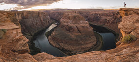 USA, Arizona, Colorado River, Horseshoe Bend, young man standing on viewpoint - KKAF02842
