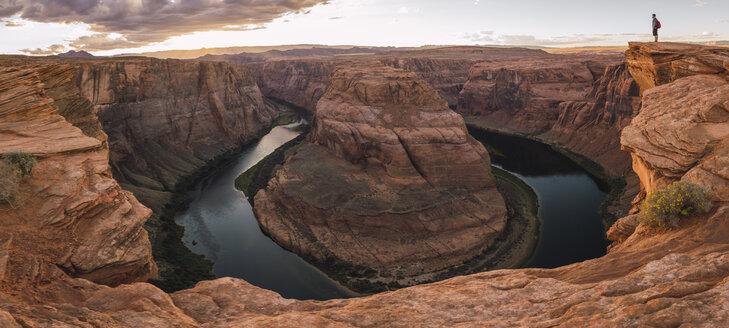 USA, Arizona, Colorado River, Horseshoe Bend, young man standing on viewpoint - KKAF02842