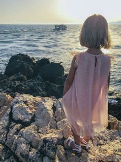 Greece, Parga, girl at the coast at sunset - PSIF00145