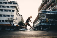 Action shot of a man jumping in the city - INGF05721