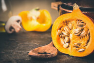 Close-up of an orange pumpkin on a table - INGF05736