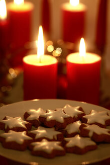 Plate of cinnamon stars at candle light - JTF01129