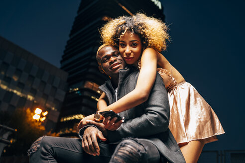 Portrait of young couple in love at night in the city - OCMF00057