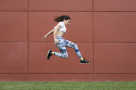 Fit young woman jumping midair - FMGF00095