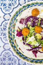 Falafel, leaf salad, red and white cabbage and yogurt sauce with mint on wrap - LVF07533