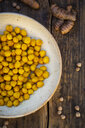 Bowl of roasted chickpeas flavoured with curcuma - LVF07536
