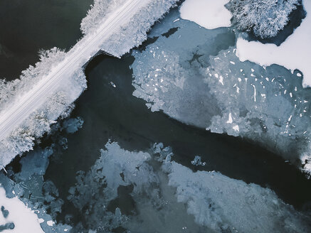 High angle view of person paddleboarding in lake during winter - CAVF53206