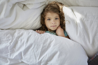 High angle portrait of girl lying on bed at home - CAVF53236