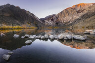 Scenic view of calm Convict Lake by mountains against clear sky - CAVF53269