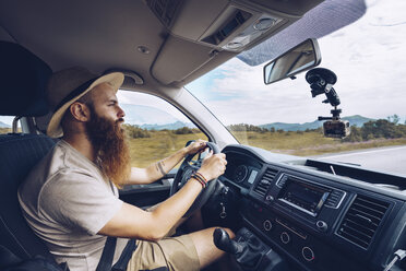 Norway, Lofoten, bearded man driving - RSGF00052