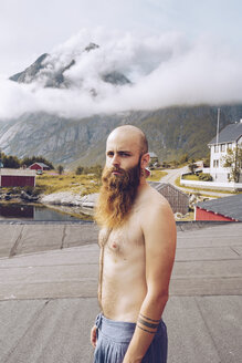 Norway, Lofoten, portrait of shirtless man with full beard - RSGF00061
