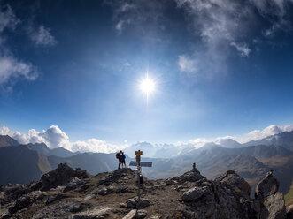 Border region Italy Switzerland, father and son on peak of Piz Umbrail - LA02151