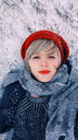 Young woman lying down over the snow at winter - INGF06337