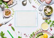 High angle view of an ipad on a table with fresh ingredients - INGF06346