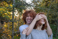 Brother and sitser having fun together in autumn - LBF02163
