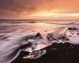 Scenic view of Jokulsarlon Lagoon against cloudy sky during sunset - CAVF53931