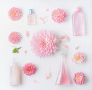 Close-up of pink flowers in and cosmetic products - INGF06449