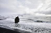 Scenic view of Dyrholaey Iceland and Arnardrangur rocks during winter - CAVF54050