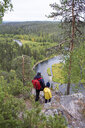 Finland, Oulanka National Park, mother and daughter standing in pristine nature - PSIF00155