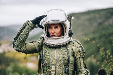 Portrait of woman in space suit exploring nature - OCMF00086