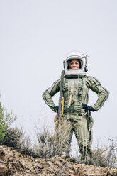 Woman in space suit exploring nature - OCMF00089