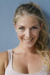 Portrait of smiling blond woman - KNSF05273
