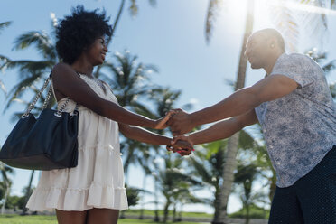 USA, Florida, Miami Beach, happy young couple at palm trees in summer - BOYF00784