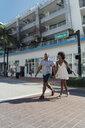 USA, Florida, Miami Beach, happy young couple crossing the street - BOYF00799