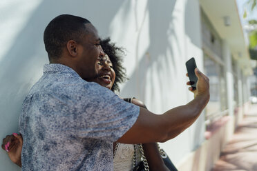 Happy young couple taking a selfie - BOYF00805