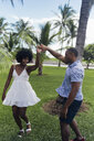 USA, Florida, Miami Beach, happy young couple dancing in a park in summer - BOYF00886