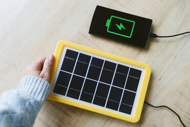 Renewable energy technology, solar panel charging a mobile phone battery - GEMF02491