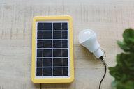 Renewable energy technology, solar panel charging a light bulb - GEMF02494