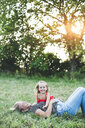 Portrait of happy girl with mother on meadow - HMEF00068