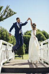 Bridal couple enjoying their wedding day in a park - JSMF00572