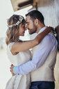 Bridal couple enjoying their wedding day on the beach - JSMF00587