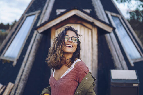 Portrait of a laughing young woman infront of a Finnish house - RSGF00104