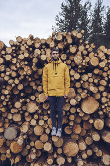 Young man standing on a stck of wood, giving the illusion of hovering - RSGF00125