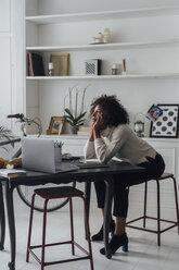 Freelancer sitting at her desk, daydreaming - BOYF00937