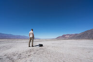 USA, California, Death Valley, back view of man standing in the desert - KKAF02966