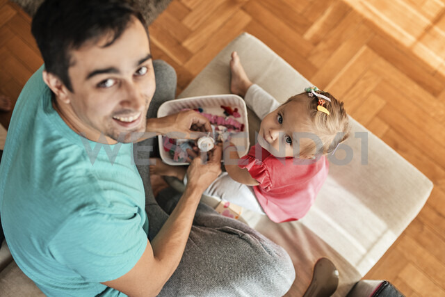 Little girl and her father playing together at home - ZEDF01744