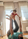 Father playing with his little daughter at home - ZEDF01759