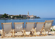 Croatia, Istria, Porec, Old town, Euphrasian Basilica, beach loungers in the foreground - WWF04438